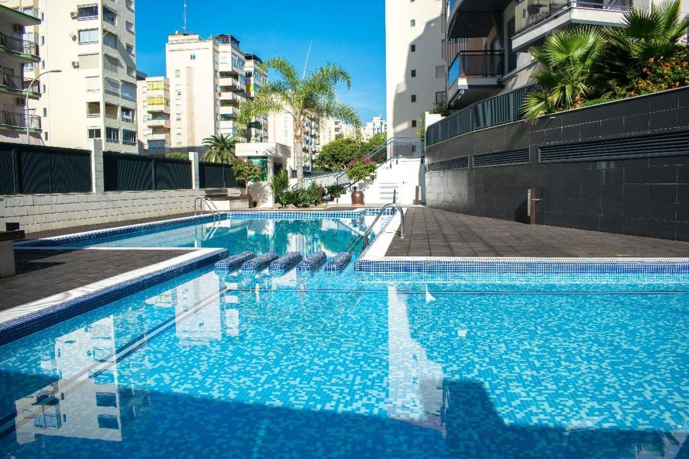Apartamento en playa de gandia con piscina comunitaria y garaje incluido - imagenInmueble1