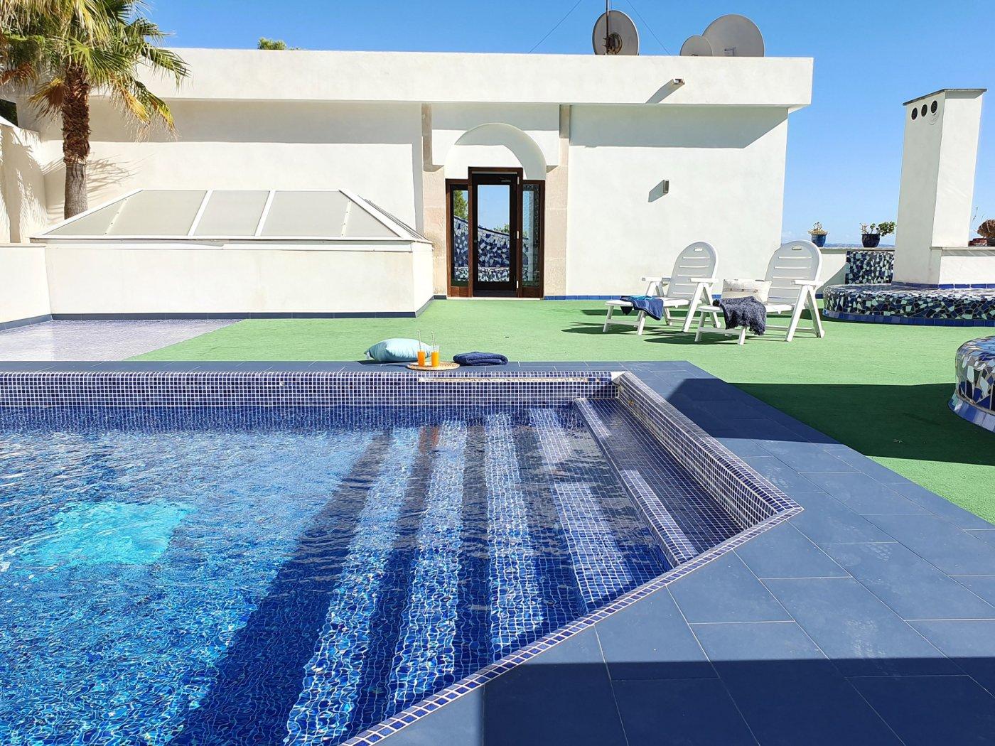 Exclusivo bajos con piscina y vistas al mar en cas català nou - imagenInmueble3