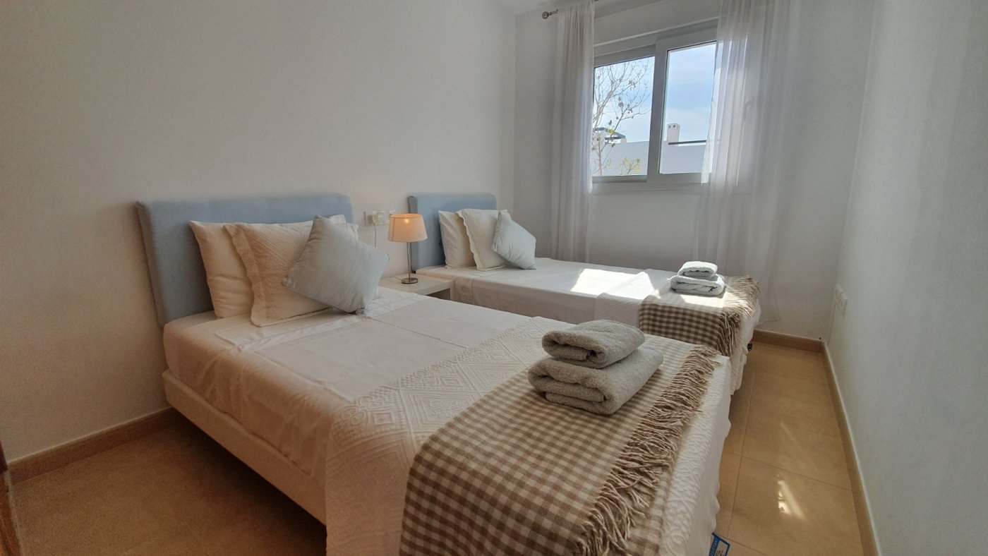 Gallery Image 11 of Immaculate 2 Bedroom Apartment with Pool Views and Roof Terrace in Jardin 9, Condado de Alhama
